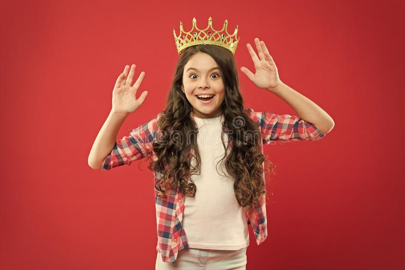 Happiness and joy. I am just the best. Kid wear golden crown symbol of princess. Girl cute baby wear crown. Become stock photos