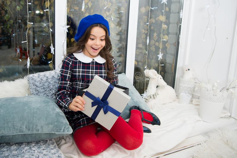 Happiness and joy. Kid at home relaxing on cozy window sill. Magic moment. Happy winter holidays. Small girl opening. Gift. New year. Santa claus gift. Little stock images