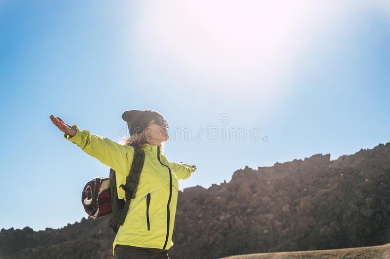Happiness and joyful feeling with beautiful active people standing woman with open arms enjoying the sun in hiking outdoor leisure stock images
