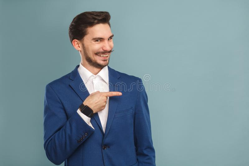 Happiness man pointing finger at copy space and toothy smiling stock photography
