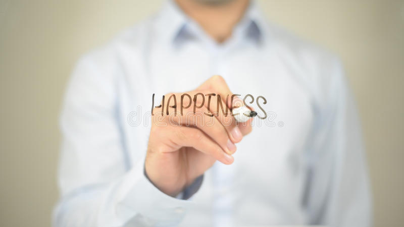 Happiness , Man writing on transparent screen. High quality royalty free stock photos