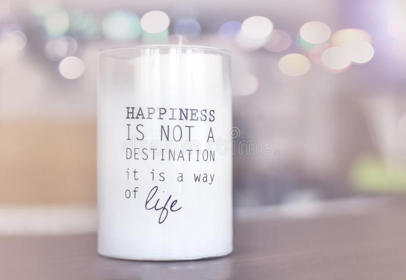 `Happiness is not a destination is a way of life`. Candle royalty free stock image