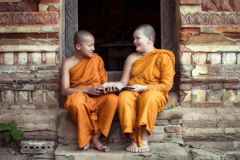 Happiness of Novice monk buddhist religion buddhism in Thailand stock photography