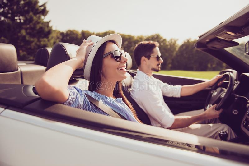 Happiness, reach destination, honeymoon, freedom, relationship,. Road, escape, speed ride lifestyle. Side profile view of carefree cheerful romantic married stock photos
