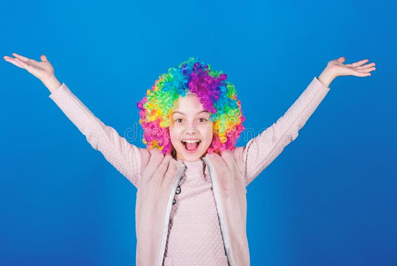 Happiness only real when shared. Happy little girl child wearing bright wig hair smiling with happiness. The child of so. Much happiness and beauty. Childs royalty free stock photos