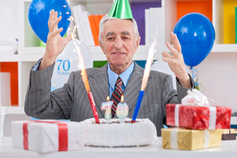 Happiness senior man celebrating 70th birthday royalty free stock image