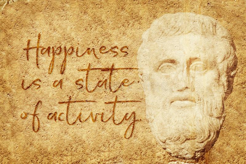 Activity state Aristotle. Happiness is a state of activity - famous quote of ancient Greek philosopher Aristotle written on stone wall with carved relief royalty free illustration