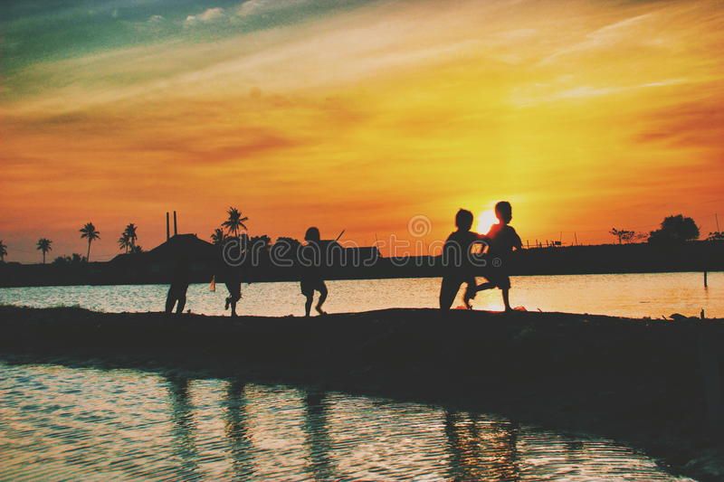 Happiness under sunset stock images