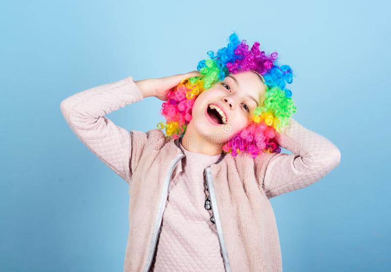 Happiness is a way of life. Happy small girl with bright synthetic hair smiling with happiness. Raising happy child for royalty free stock photography