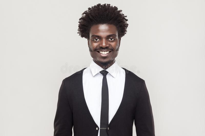 Happiness well dressed afro businessman looking at camera, tooth royalty free stock photography