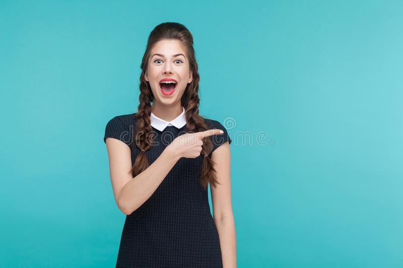 Happiness woman pointing finger at copy space. royalty free stock photos