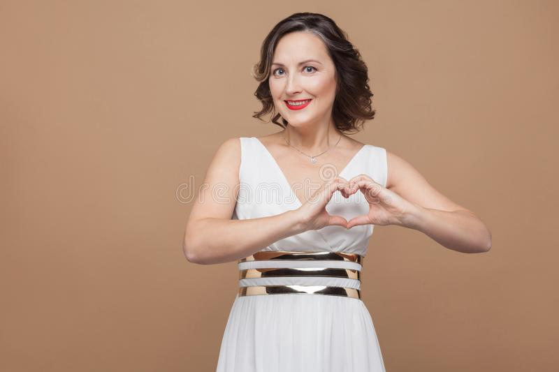 Happiness woman showing heart shape by hands royalty free stock image