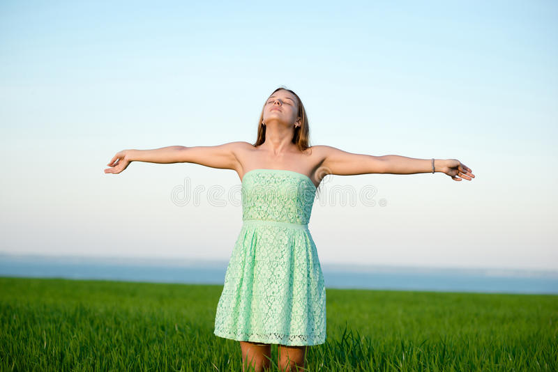 Happiness woman stay outdoor under sunlight of sunset royalty free stock photography