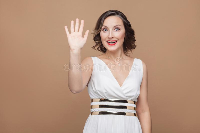 Happiness woman toothy smile and showing hi, hello sign stock images