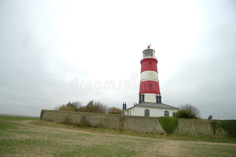 Happisburgh famous red and white lighthouse. Happisburgh Lighthouse in Happisburgh on the North Norfolk coast is the only independently operated lighthouse in royalty free stock photography