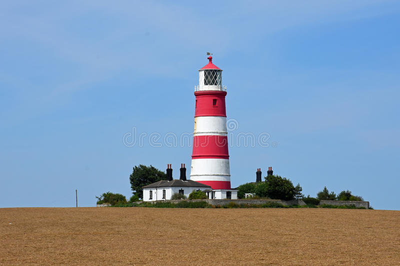 Happisburgh Lighthouse, Norfolk, England. Happisburgh Lighthouse is the oldest working light in East Anglia, and the only independently run lighthouse in Great royalty free stock image