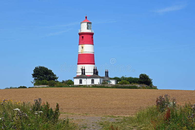 Happisburgh Lighthouse, Norfolk, England. Happisburgh Lighthouse is the oldest working light in East Anglia, and the only independently run lighthouse in Great stock photo