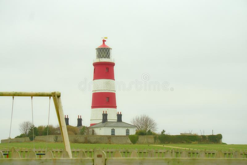 Coastal landmark of Happisburgh lighthouse,. Happisburgh Lighthouse in Happisburgh on the North Norfolk coast is the only independently operated lighthouse in stock photos