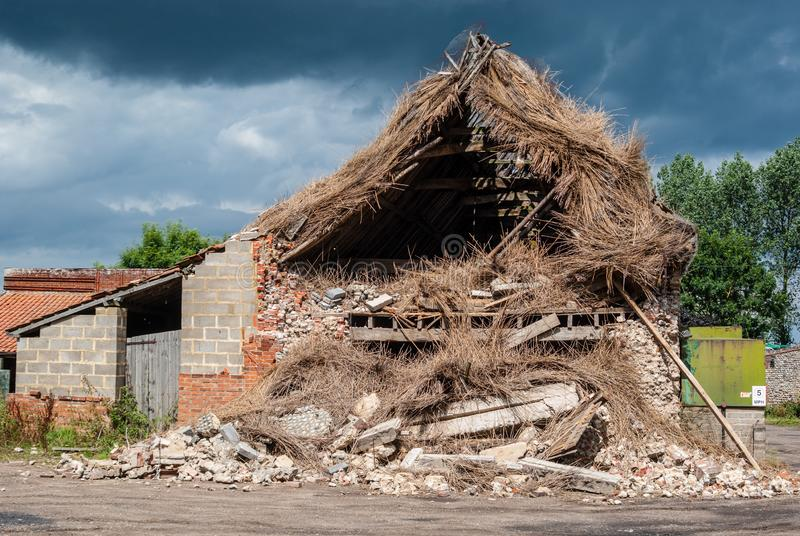 Storm damaged barn. Happisburgh Norfolk, England - 28 July, 2010 - extensive damage caused to barn by recent storm stock photo