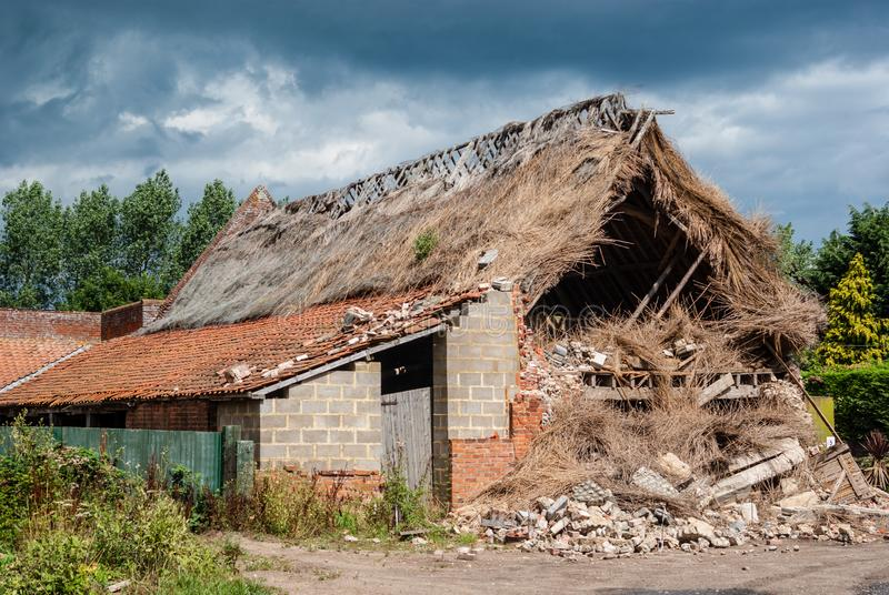 Storm damaged barn. Happisburgh Norfolk, England - 28 July, 2010 - extensive damage caused to barn by recent storm royalty free stock photography