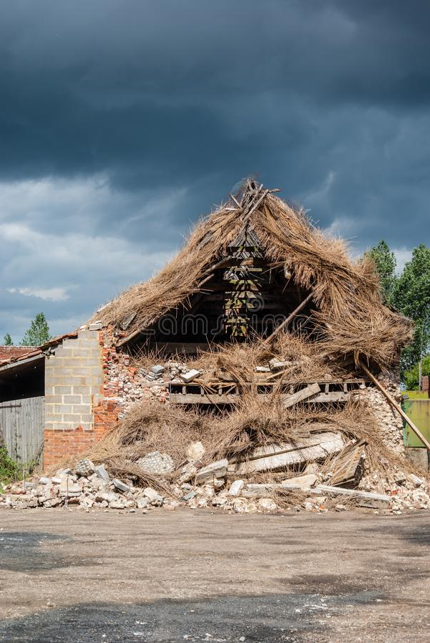 Storm damaged barn. Happisburgh Norfolk, England - 28 July, 2010 - extensive damage caused to barn by recent storm royalty free stock photo