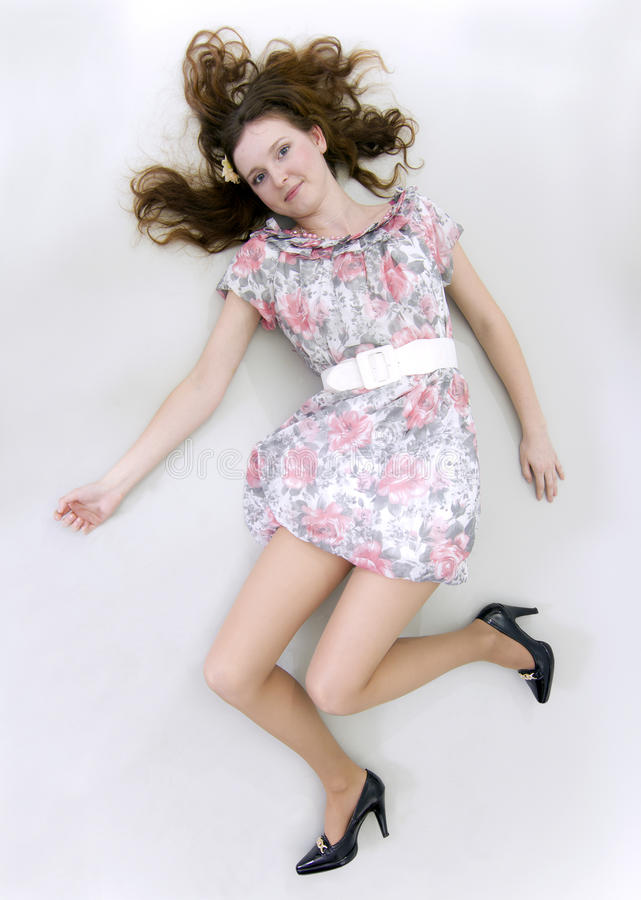 The happy. The young woman lies on a white background stock photography
