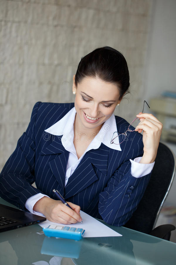Happy accountant write on blank paper. In office, teeth smile royalty free stock images
