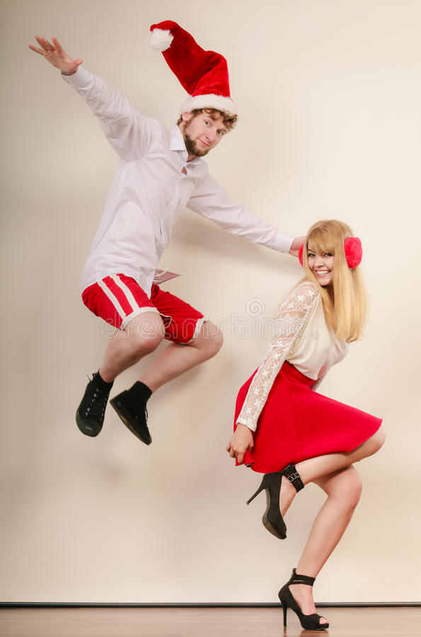 Happy active couple dancing and jumping. royalty free stock photography