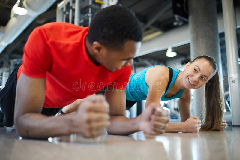 Doing plank together stock photo