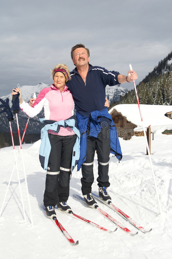 Happy active seniors. A senior couple outdoor in a winter setting. The active couple is about to go crosscountry skiing stock photos