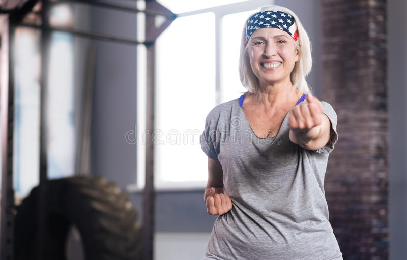 Happy active woman practicing self defence stock image