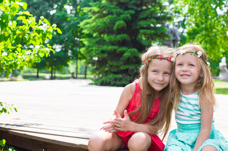 Happy adorable little girls enjoy warm summer day stock photography