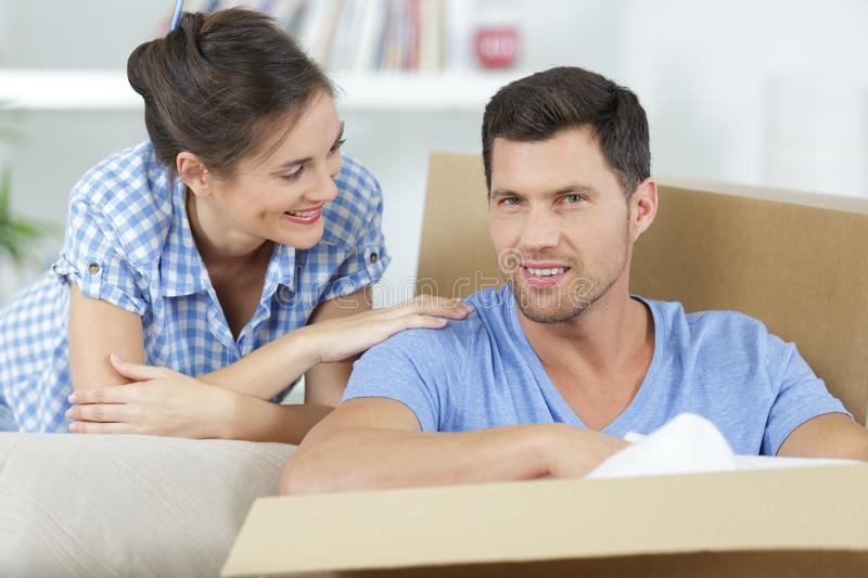 Happy adult couple moving out or in to new home royalty free stock images