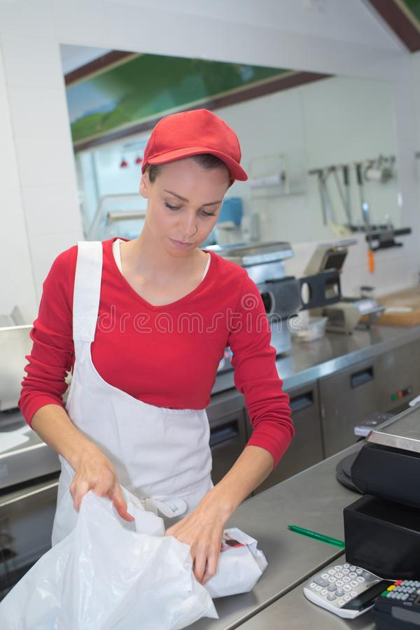 Happy adult female butcher royalty free stock images