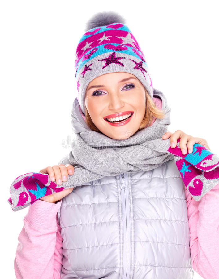 Happy adult girl in winter clothes with bright positive emotions. Photo of a happy adult girl in winter clothes with bright positive emotions - isolated on white royalty free stock images