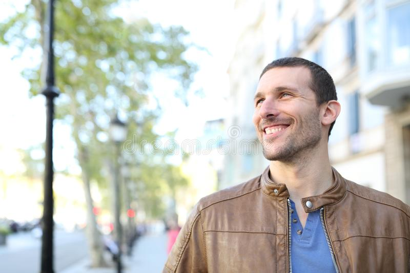 Happy adult handsome man looking at side in the street royalty free stock photography