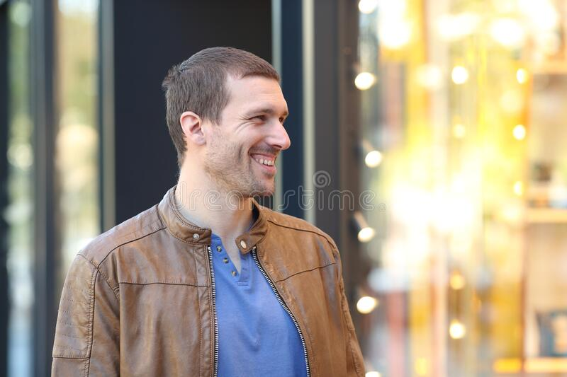 Happy adult man looking products at store window royalty free stock images