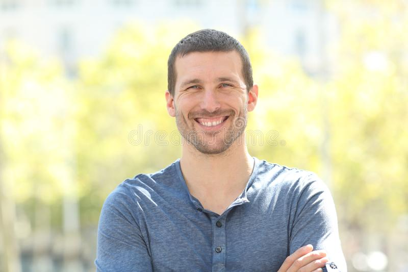 Happy adult man posing looking at camera in the street. Front view portrait of a happy adult man posing looking at camera in the street royalty free stock photography