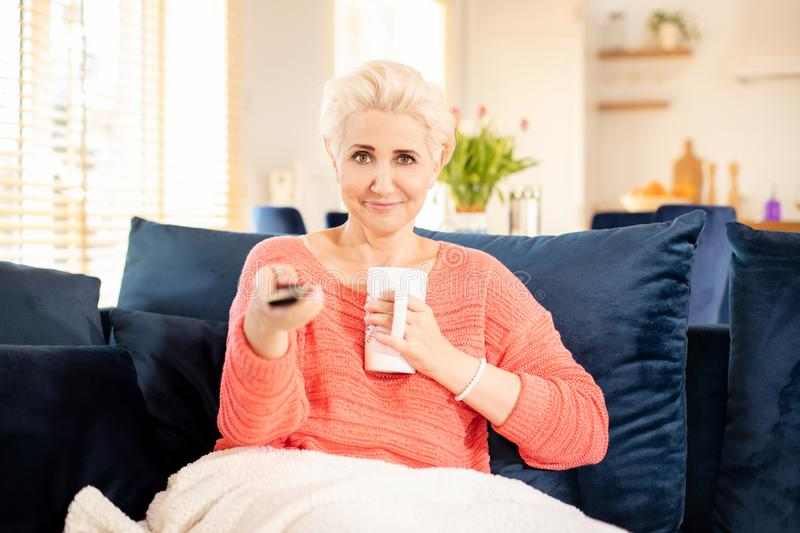 Happy adult woman relaxing at home stock images