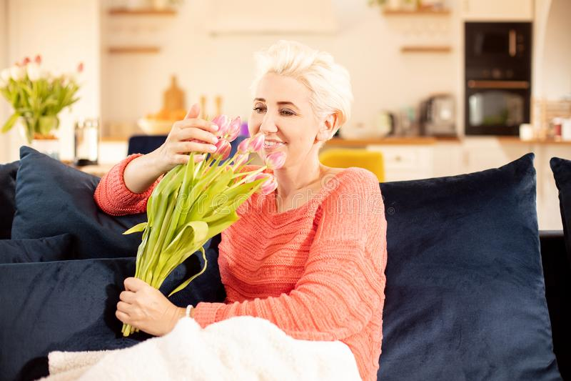 Happy adult woman relaxing at home royalty free stock photos