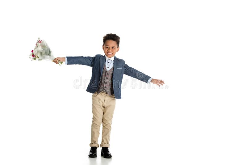 happy african american boy standing with bouquet and open arms royalty free stock image