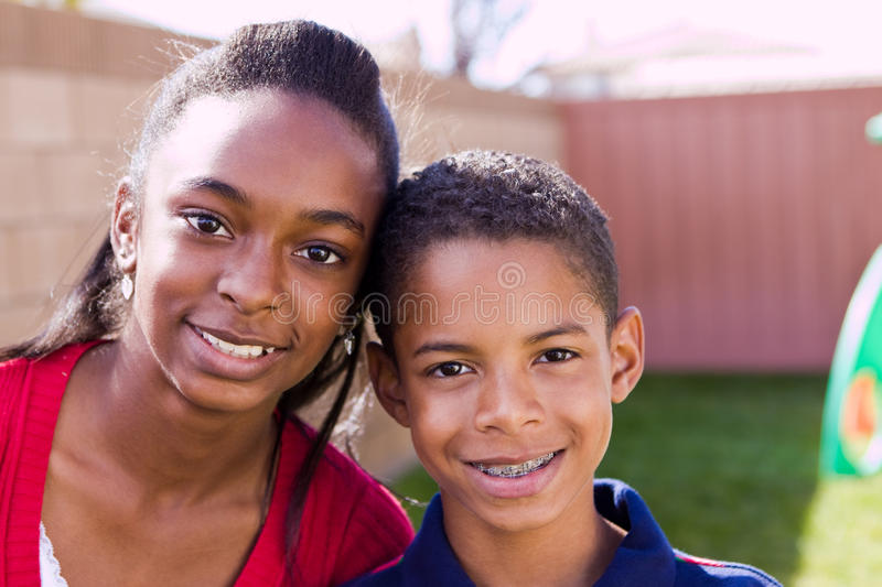 Happy African American brother and sister smiling. royalty free stock image