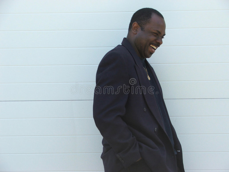 Happy African American Businessman Laughing stock image