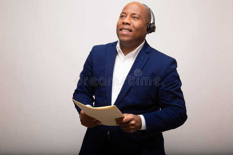 Happy African American Businessman Looks Up royalty free stock photo