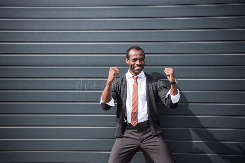 Happy african american businessman standing outdoors royalty free stock photos