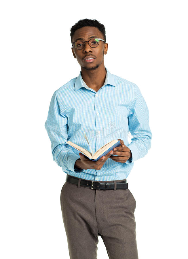 Happy african american college student standing with book in his stock photography