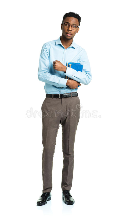 Happy african american college student standing with books in hi royalty free stock photography