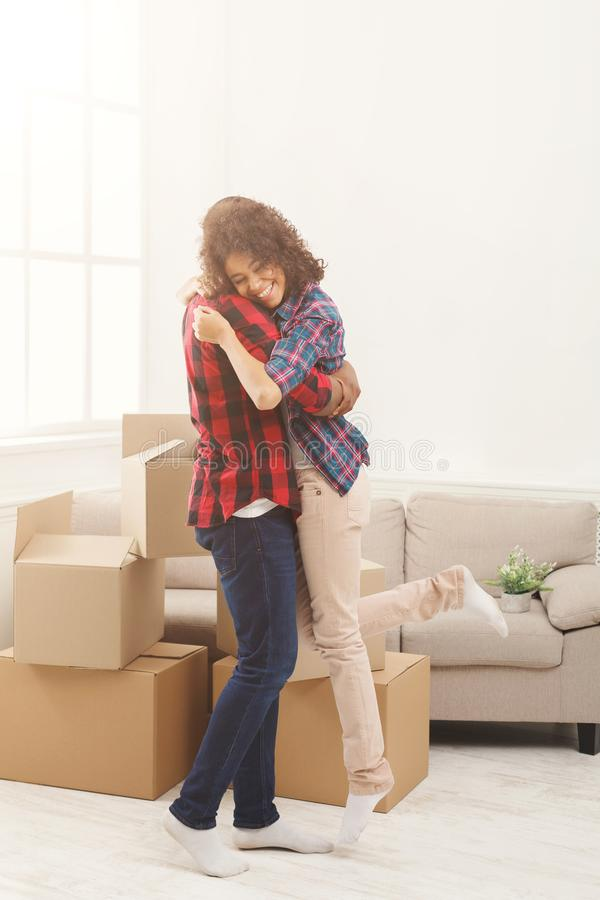 Happy african-american couple embracing at home stock photos