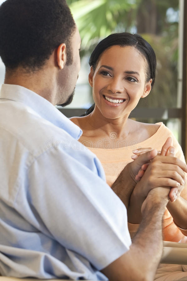 Happy African American Couple Holding Hands royalty free stock image