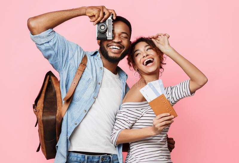 Happy african-american couple ready for vacation, crop stock photography